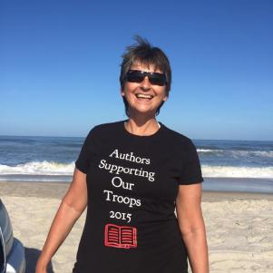 Marianne Sciucco wearing Authors Supporting Our Troops T-shirt at Assateague Island